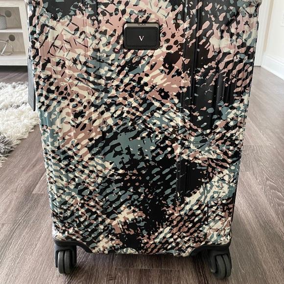 Tumi 4 Wheeled Packing Case multi color